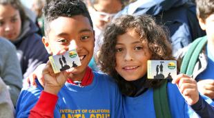 EKIP photo of 2 kids with park passes